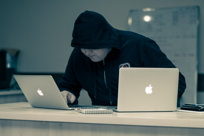 man_black_hoodie_computers