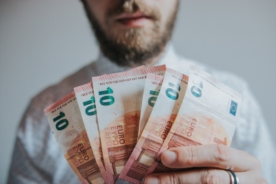 bearded man with 10 eur bills