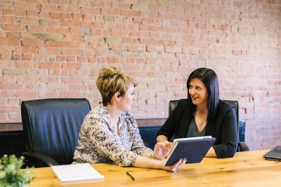 women_talking_business_meeting_office